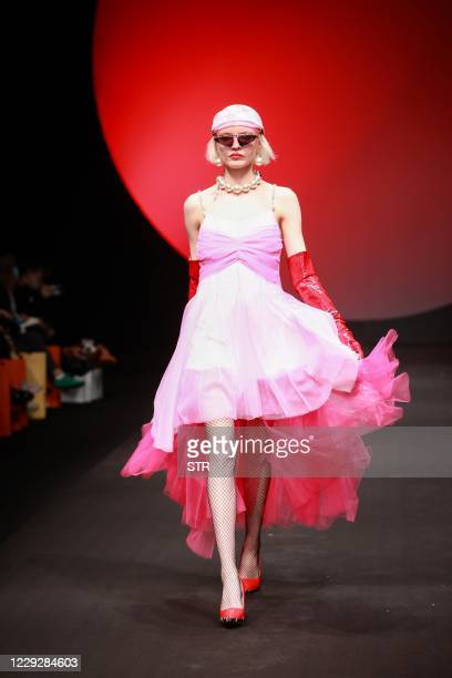 The photo taken on October 25 2020 shows a model displaying a creation from Devil Beauty collection by Li Yiwen during the China Fashion Week in...