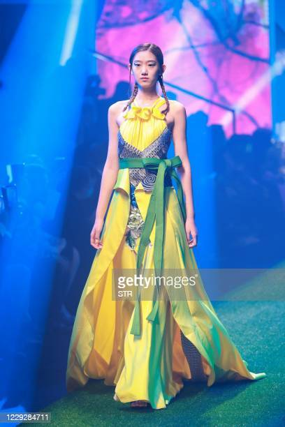 The photo taken on October 25, 2020 shows a model displaying a creation from The Genius Mom x Dong Xiang Female Embroider collection by Zhang Zhaoda...