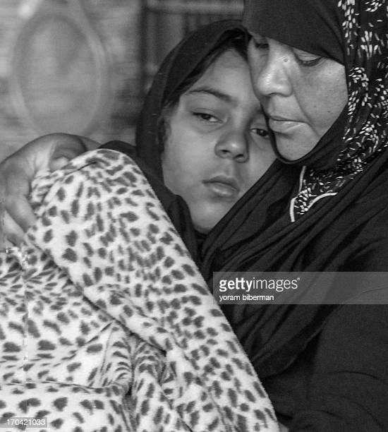 CONTENT] The photo was taken at the old city of Jerusalem It presents a sitting mother that hugs her daughter They are in great intimacy The photo is...