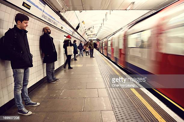 The photo was taken in London underground, while people waiting for the train.