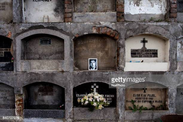 The photograph of Osvaldo Burgos Lavoz a disappeared detainee on September 15 lies in one of the tombs of the Catholic cemetery of Osorno Chile on 29...
