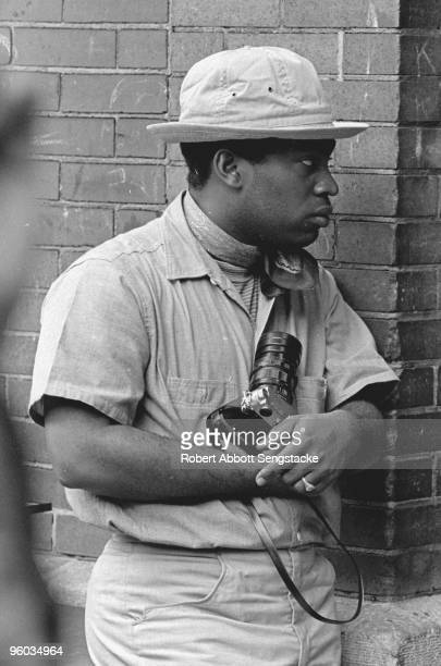 The photographer Billy 'Fundy' Abernathy holding his Leica M3 camera during Martin Luther King Jr's funeral Memphis TN April 1968
