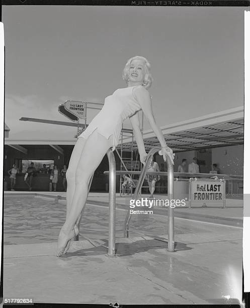 The photographer forgot to get the name of the new style bathing suit that Miss Mamie Van Doren Universal star is modeling here at the Hotel Last...