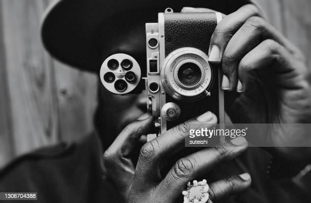 de fotograaf - fotosessie stockfoto's en -beelden