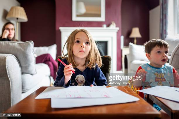 The photographer's children, Charlotte Rose, 5 and Alexander James practice their school work as home schooling continues on April 01, 2020 in...