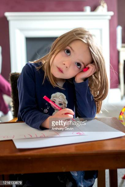 The photographer's daughter Charlotte Rose practices her school work as home schooling continues on April 01 2020 in Manchester United Kingdom The...