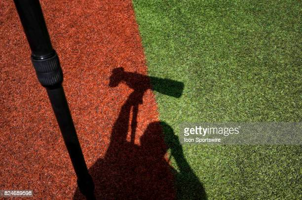 The photographer's shadow is cast on the artificial turf before the regular season MLB game between the Los Angeles Angels and the Toronto Blue Jays...