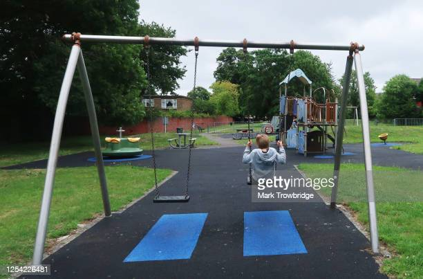 The photographers son plays on a swing at a reopened playground at St Mary's Field on July 04, 2020 in Wallington, England. Playgrounds and outdoor...