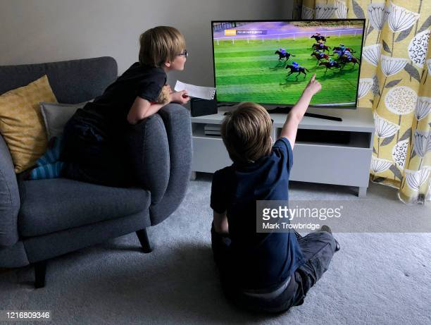 The photographer's sons watch the virtual Grand National on April 04 2020 in Wallington United Kingdom The Grand National horse race one of the...