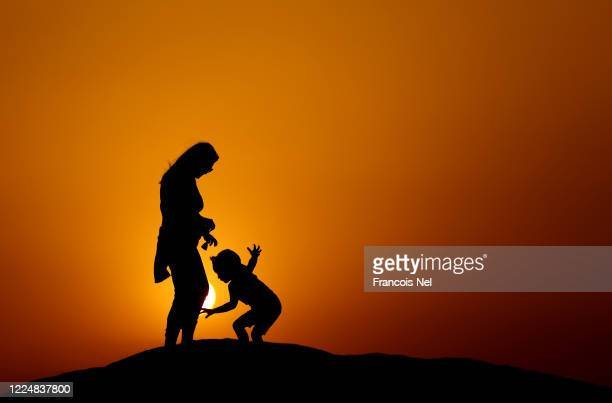 The photographer's wife and son enjoys the sunset on May 14 2020 in Dubai United Arab Emirates The Coronavirus pandemic has spread to many countries...