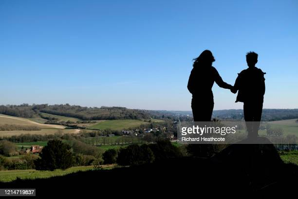The photographer's wife and son get some fresh air on West Wycombe Hill on March 25, 2020 in High Wycombe, United Kingdom. British Prime Minister,...