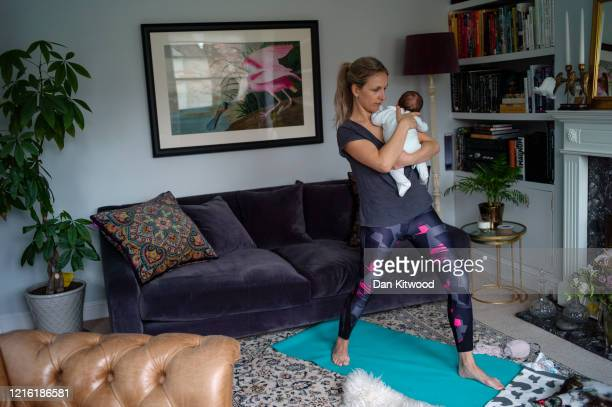 The photographer's wife and son, Katy Boaler and Leo, take part in a live streamed baby yoga class as the country continues to be locked down on...