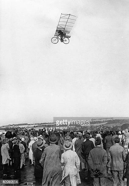 The photography shows Max Wiedenhft with his flying rocket bike over the Tempelhofer field in Berlin It's a april fool and a photomontage Photograph...