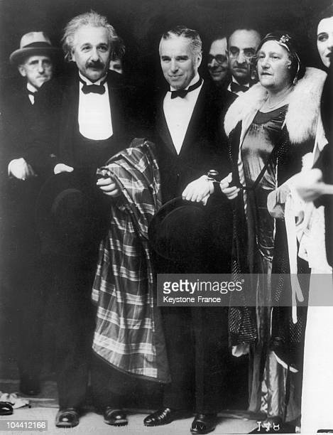 The physicist Albert EINSTEIN, his wife Elsa LOWENTHAL and the film actor/director Charles CHAPLIN in Los Angeles, United States. January 1931.