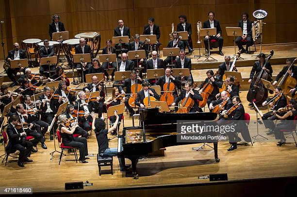 'The pianist Giovanni Allevi playing with the orchestra at at Auditorium Manzoni in a photo shooting Bologna Italy 18th November 2012 '