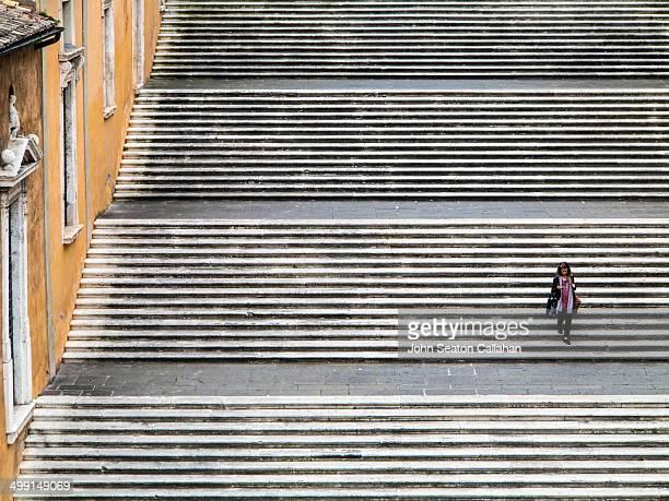 The Piazza del Campidoglio on Capitoline Hill, woman descending staircase.