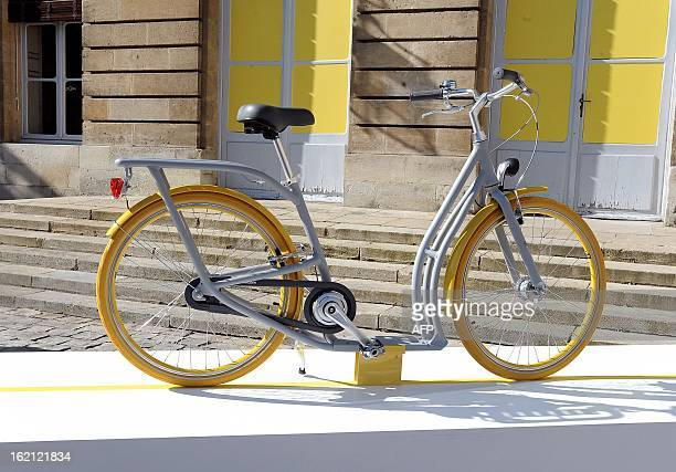 'The Pibal' the city of Bordeaux's new hybrid urban bicycle designed by Philippe Starck is displayed on February 19 2013 during its presentation in...