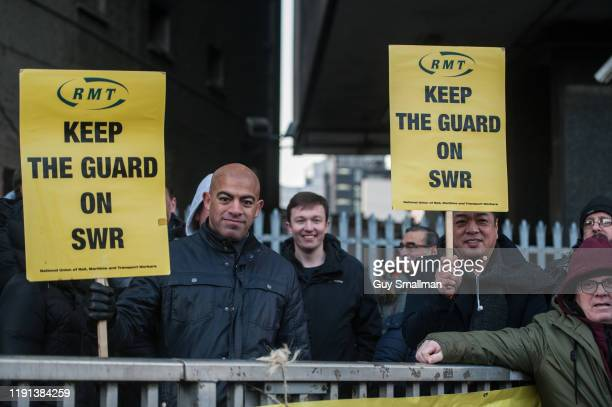 The picket line of striking RMT guards at Waterloo station on December 2, 2019 in London, England. RMT rail union members are beginning a 27 day...