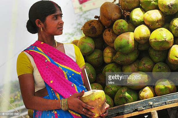 The picture featuring coconut water seller on the street on May 15 2013 in New Delhi India