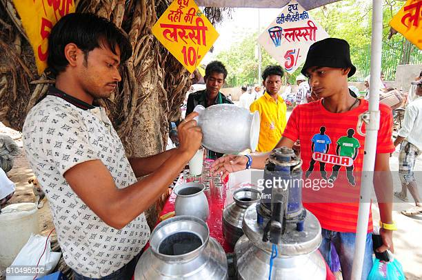 The picture featuring Lassi seller on May 15 2013 in New Delhi India