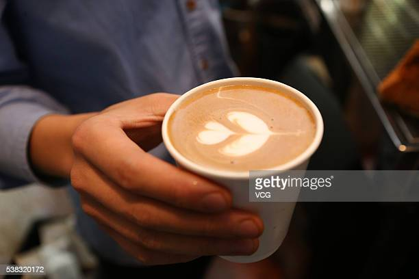 The picture shows a cup of brewed coffee in a 2squaremeter cafe named Manner Coffee stands at Nanyang Road on June 4 2016 in Shanghai China The...
