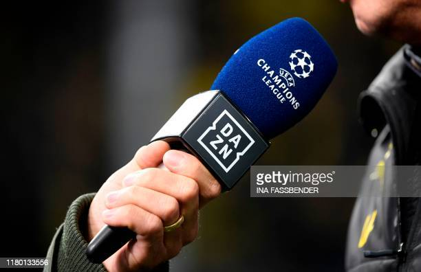 The picture shows a microphone of broadcaster DAZN during an interview prior to the UEFA Champions League Group F football match BVB Borussia...