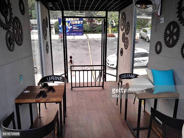The picture shows the indoor scene of a small bar built in slanted shipping container on June 19 2016 in Chengdu Sichuan province of China The bar is...