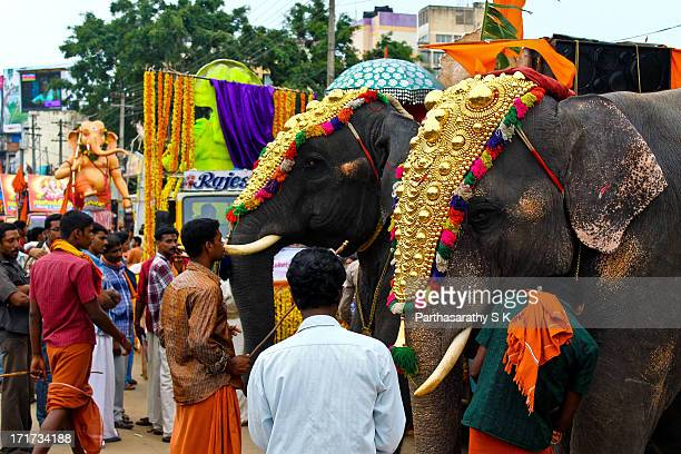CONTENT] The picture shows the Onam celebrations on the streets of Trivandrum KeralaPeople offer prayers to the idols being carried through the...