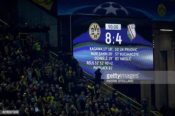 The picture shows the stadium display with the final score of 84 after the Champions League football match between Borussia Dortmund and Legia...