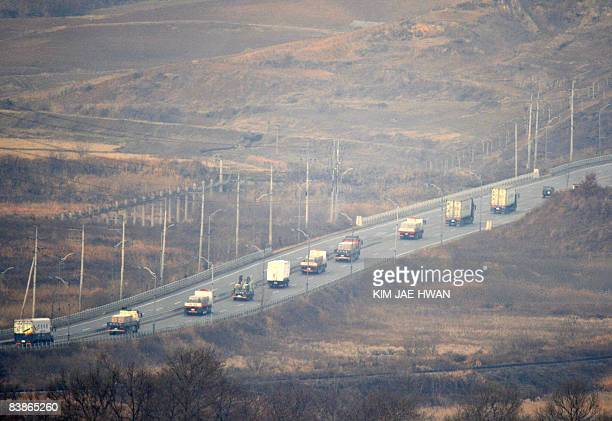 The picture taken from an army observatory post at Dorasan in Paju on December 1 2008 shows a convoy of South Korean cargo trucks and vehicles...