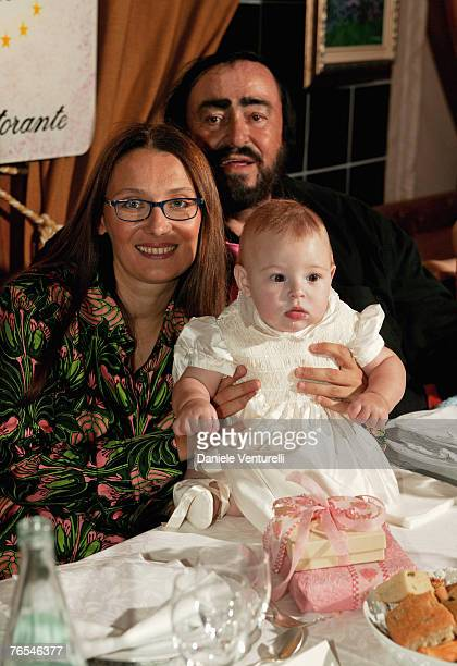 The picture taken in August 30, 2003 in Modena, Italy, shows opera singer Luciano Pavarotti with his wife Nicoletta Mantovani and their daughter...