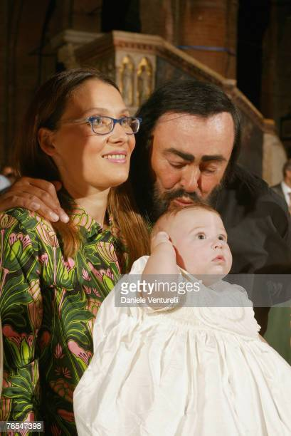 The picture taken in August 30, 2003 in Modena, Italy, shows opera singer Luciano Pavarotti with his wife Nicoletta Mantovani attending the...