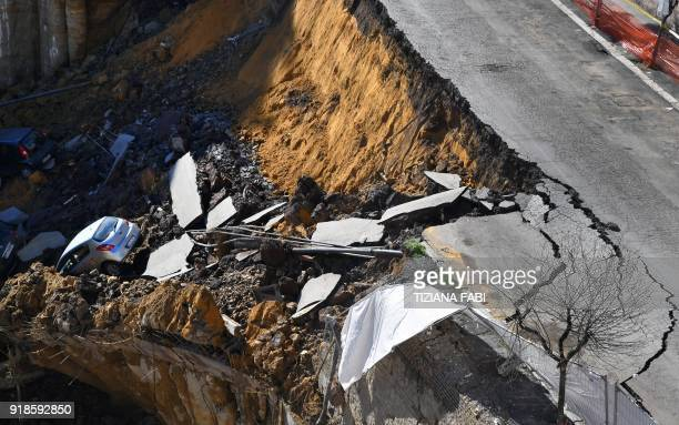 The picture taken on February 15 2018 in the street of Balduina's district in Rome shows a huge sinkhole that opened up the day before in Rome...
