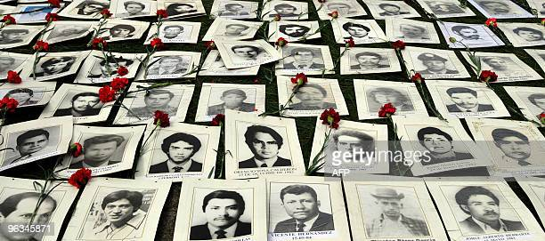 The pictures of people disappeared during the Guatemalan Civil War are exhibited on January 31 2010 in Guatemala City during the 30th anniversary of...