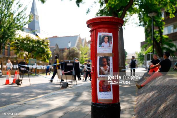 The pictures of people missing after the Grenfell Tower block fire Jessica Urbano Amava Tuccu and Amal Ahmedin are seen on a post box near the scene...