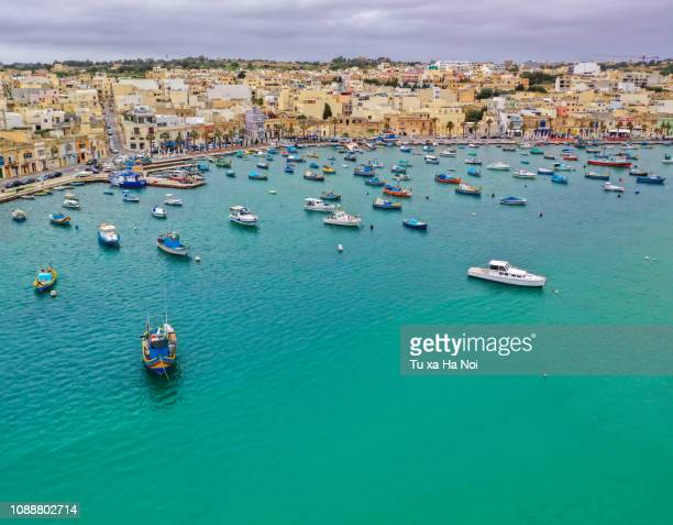the picturesque fishing village marsaxlokk view from above - marsaxlokk stock pictures, royalty-free photos & images