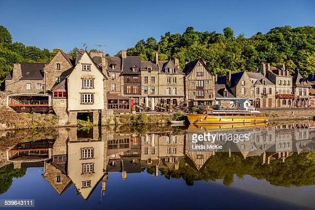 The picturesque medieval port of Dinan, reflected in the smooth Rance, Rance Estuary, Brittany, France