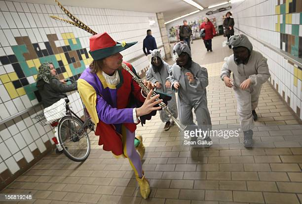 The Pied Piper of Hamelin actually city tourism employee Michael Boyer leads local children dressed as rats through a pedestrian underpass on...