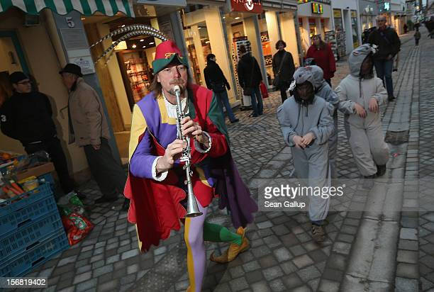 The Pied Piper of Hamelin actually city tourism employee Michael Boyer leads local children dressed as rats through a pedestrian shopping street on...