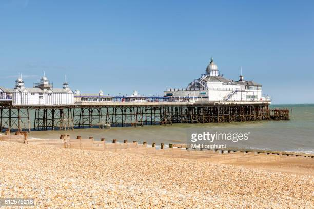 the pier and beach, eastbourne, east sussex, england - eastbourne stock pictures, royalty-free photos & images