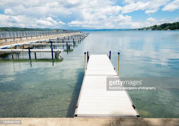 the pier at clift park in downtown skaneateles, new york, usa - skaneateles lake stock pictures, royalty-free photos & images