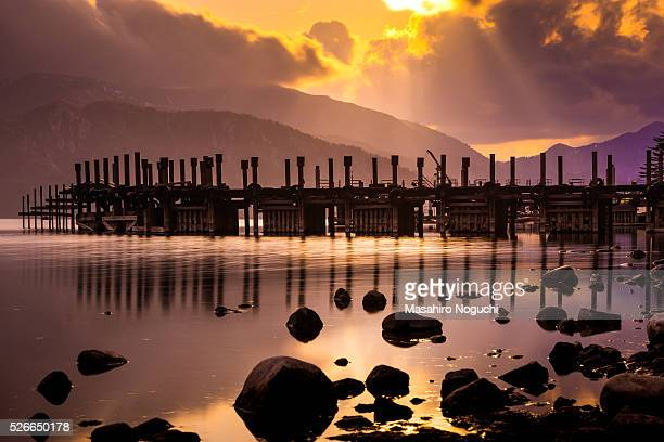 the pier at lake chuzenji in a late winter evening - 栃木県 ストックフォトと画像