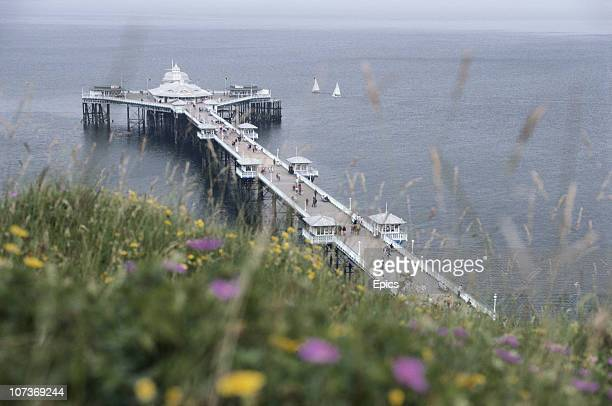 The pier at the seaside town of Llandudno on the coast between Bangor and Colwyn Bay Wales June 1982 At 2295 ft the pier is the longest in Wales and...