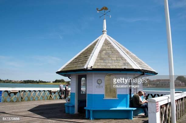 The pier head shelter of Yarmouth wooden pier provides accommodation for boat passengers and fishermen.