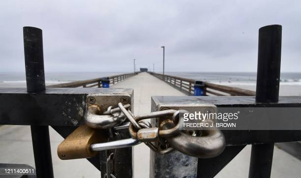 TOPSHOT The pier is seen locked and closed as it has since midMarch in Newport Beach California amid the coronavirus pandemic on April 30 2020...