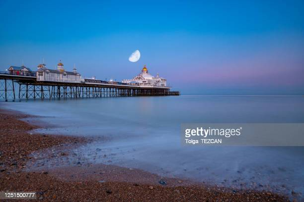 the pier of eastbourne - east stock pictures, royalty-free photos & images