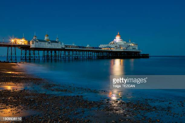 the pier of eastbourne - night stock pictures, royalty-free photos & images