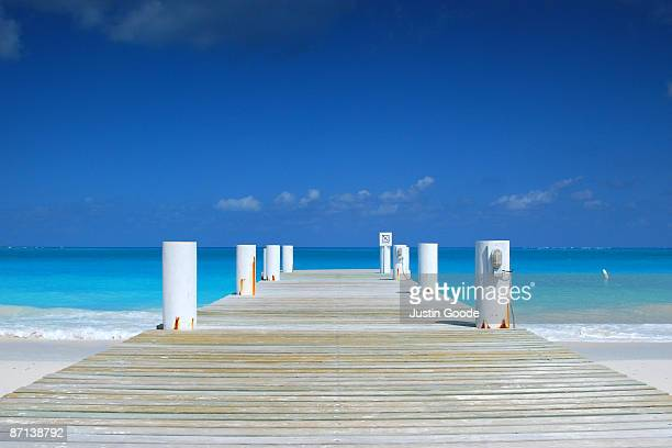 the pier  - turks and caicos islands stock pictures, royalty-free photos & images