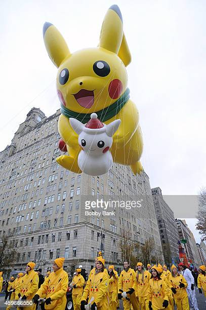 The Pikachu balloon floats at the 88th Annual Macys Thanksgiving Day Parade at on November 27 2014 in New York New York