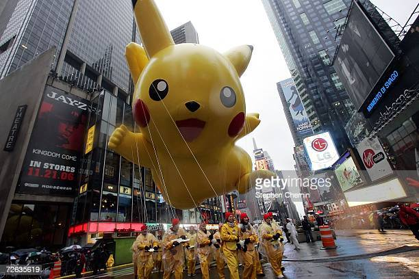 The Pikachu balloon makes its way down a rainy Broadway during the 80th Macy's Thanksgiving Day parade November 23 2006 in New York City Due to the...